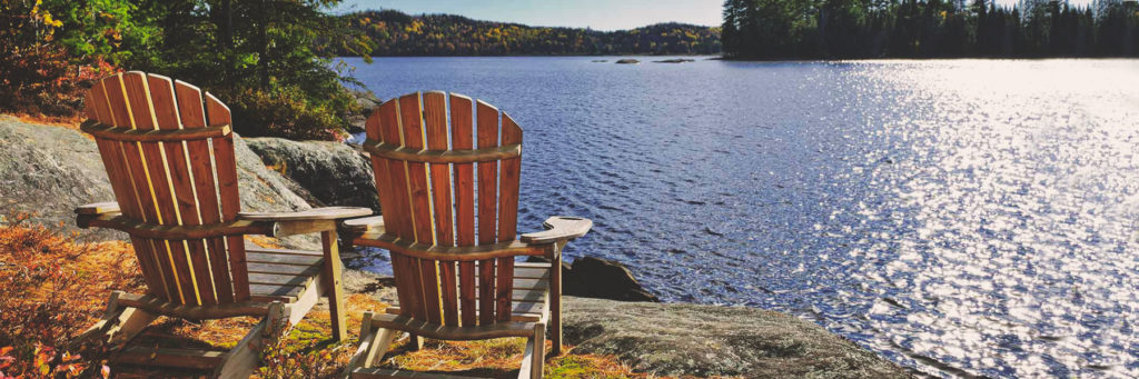 Chairs on a lake front, cottage views,